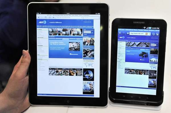 An Apple iPad, left, next to a Samsung