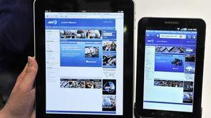 An Apple iPad, left, next to a Samsung