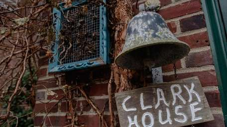 The Clark house stands during Christmastime at the