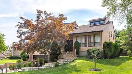 Priced at $1,299,999, this home at 22 Cresthollow