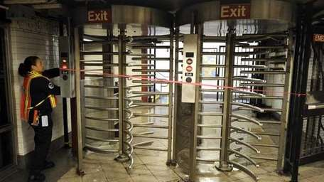 MTA worker locks up a gate at Union