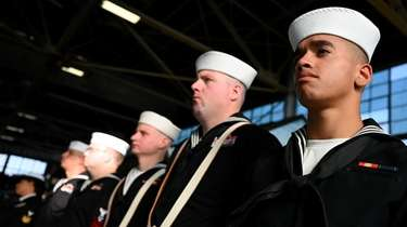 Gideon Sherry, 21, of Farmingdale, right, a Navy
