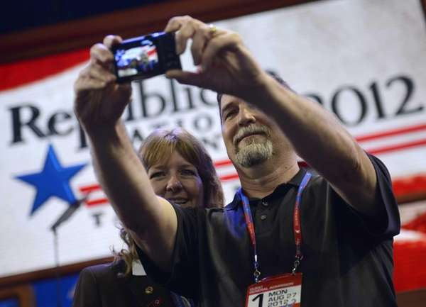Delegates take a picture of themselves before the