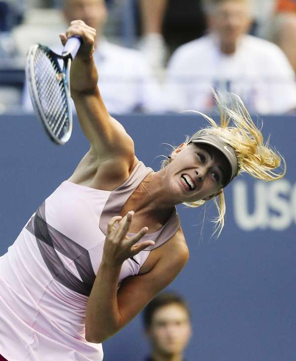 Maria Sharapova, of Russia, serves to Melinda Czink,