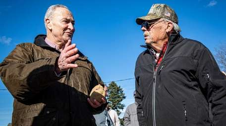 Sen. Chuck Schumer talks with farm owner John