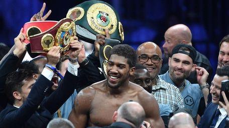 British boxer Anthony Joshua celebrates after winning the