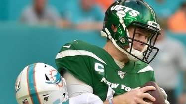 Nik Needham of the Dolphins sacks Sam Darnold