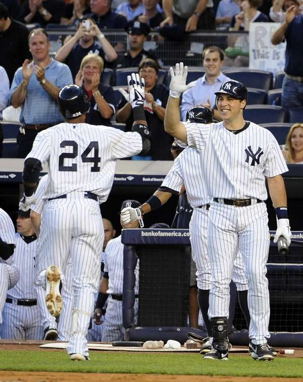 New York Yankees' Robinson Cano (24) is greeted