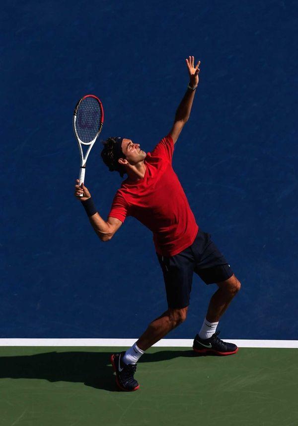 Roger Federer of Switzerland serves while practicing prior
