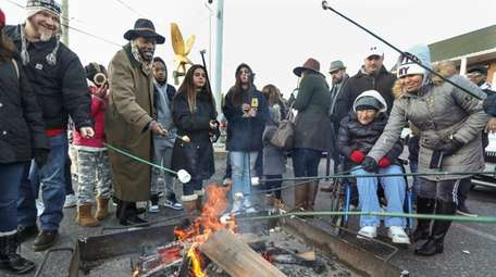 Visitors to Port Jefferson's annual Charles Dickens Festival