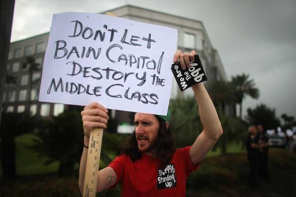 Protesters demonstrate in front of the Bain Capital