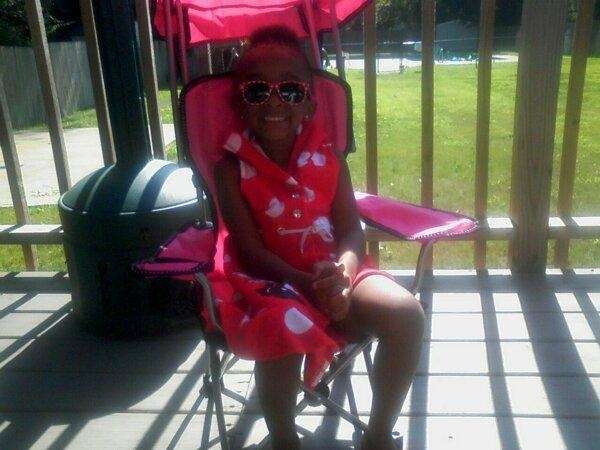 MY GRANDAUGHTER, ZIYAUNI C., RELAXING AT A BACKYARD