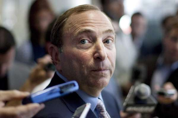 NHL Commissioner Gary Bettman speaks with reporters following