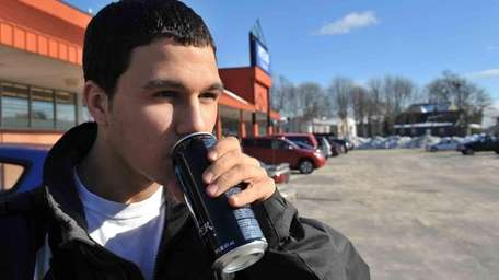Ryan Rottkamp, 15, drinks a Monster Energy drink