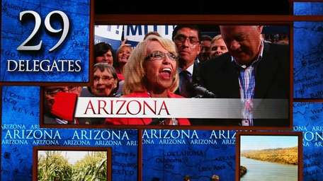 Arizona Gov. Jan Brewer appears on screen to