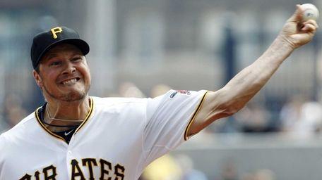 Pittsburgh Pirates starting pitcher Erik Bedard pitches during