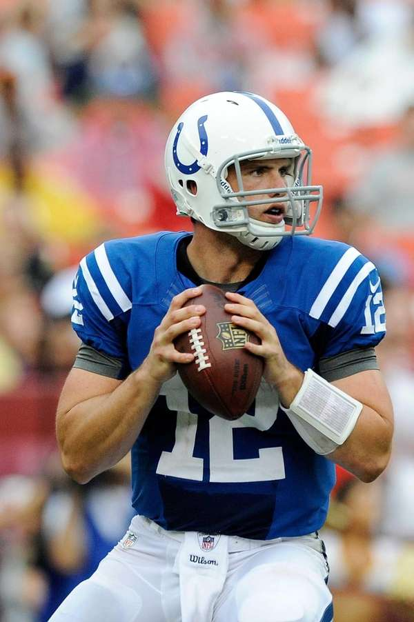 Colts quarterback Andrew Luck drops back to pass