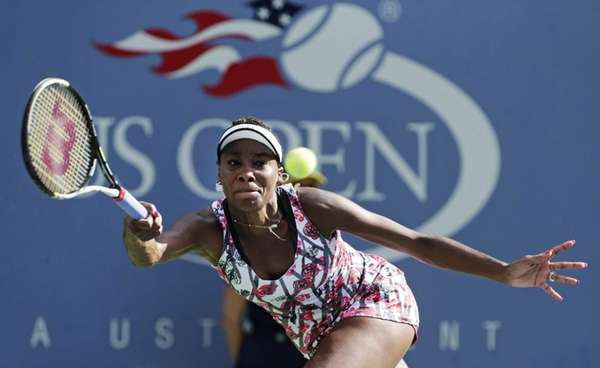 Venus Williams returns a shot to Bethanie Mattek-Sands
