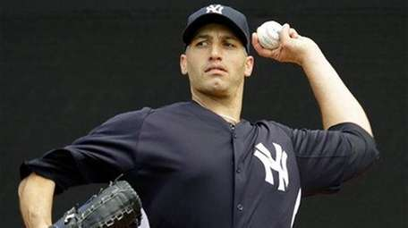 Andy Pettitte throws in the bullpen after arriving