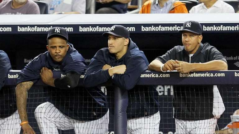 Injured Andy Pettitte and Alex Rodriguez look on