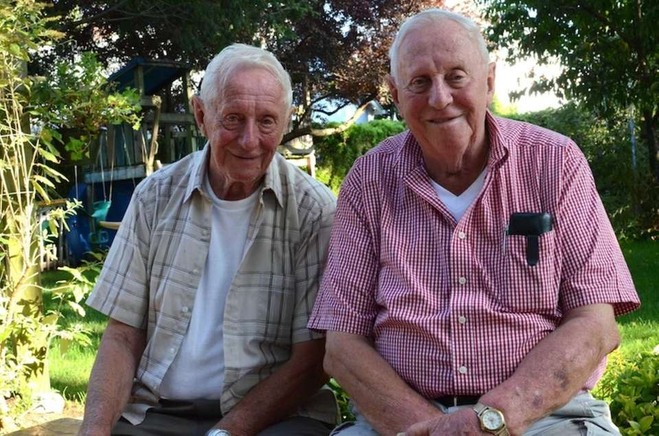 From left, twins George and Lenny Motchkavitz, 85,