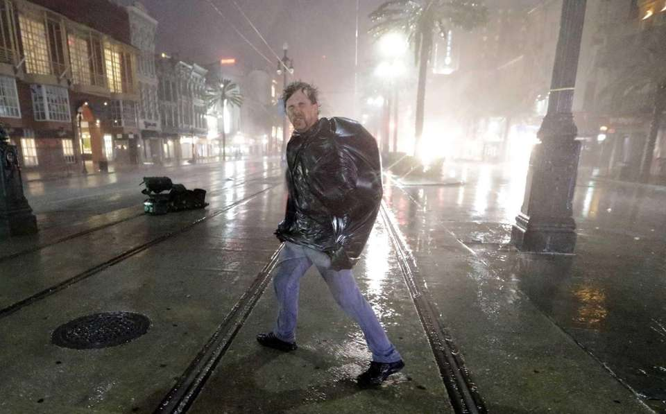 A man crosses Canal Street in New Orleans