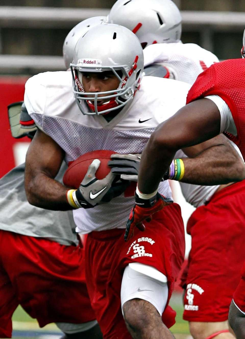 Stony Brook running back Marcus Coker slices through