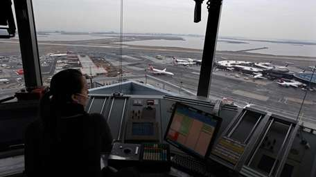 An air traffic controller looks out from the