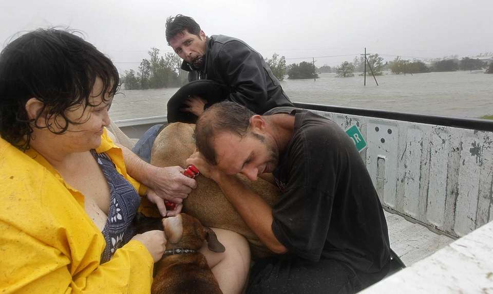 Residents who were rescued from their flooded homes