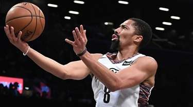 Nets guard Spencer Dinwiddie puts up a layup