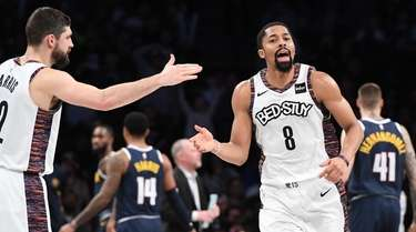 Nets guard Spencer Dinwiddie slaps five with forward