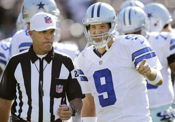 Dallas Cowboys quarterback Tony Romo talks with an