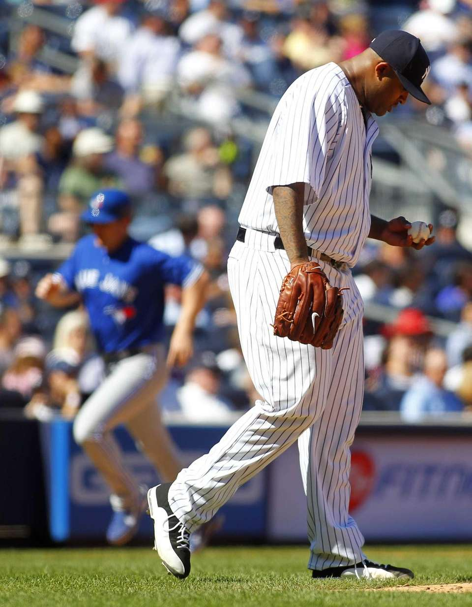 Yankees pitcher CC Sabathia looks down as Toronto