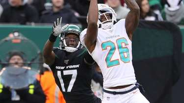 Steven Parker of the Dolphins makes an interception