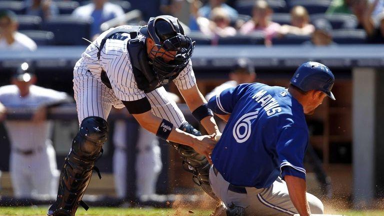 Chris Stewart of the New York Yankees tags