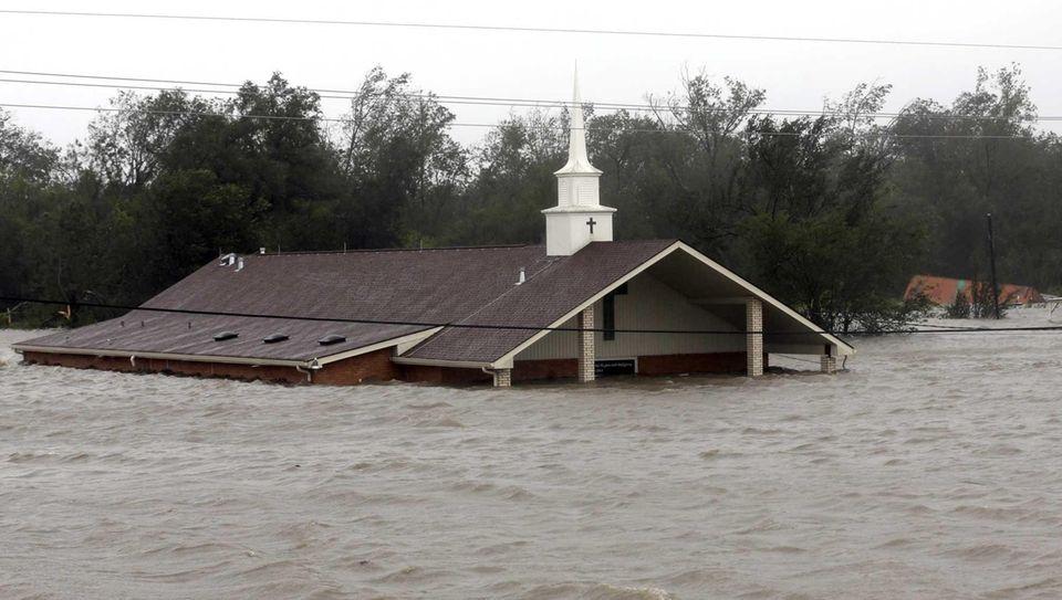 A church is flooded as Hurricane Isaac hits