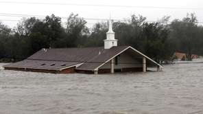 A church is flooded as Hurricane Isaac hits