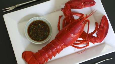Boiled lobster served with a dipping sauce of