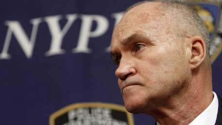 Police Commissioner Ray Kelly speaks to the press