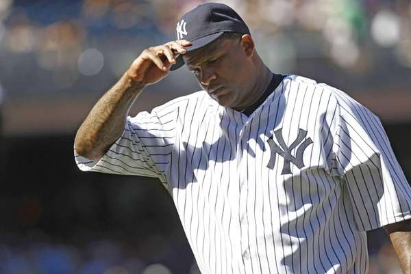 CC Sabathia adjusts his cap as he walks