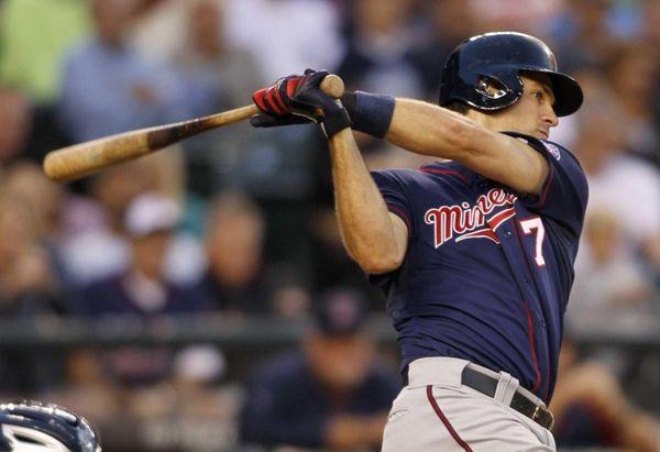 Minnesota's Joe Mauer hits a tie-breaking RBI single