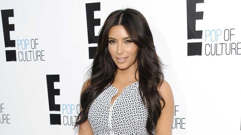 Kim Kardashian attends an E! Network event at
