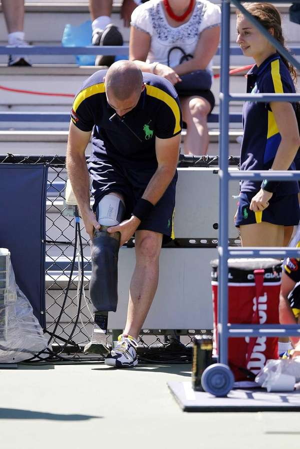 Afganistan veteran Ryan McIntosh adjusts his prosthetic leg