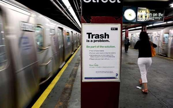 Notices mark the removal of platform trash bins