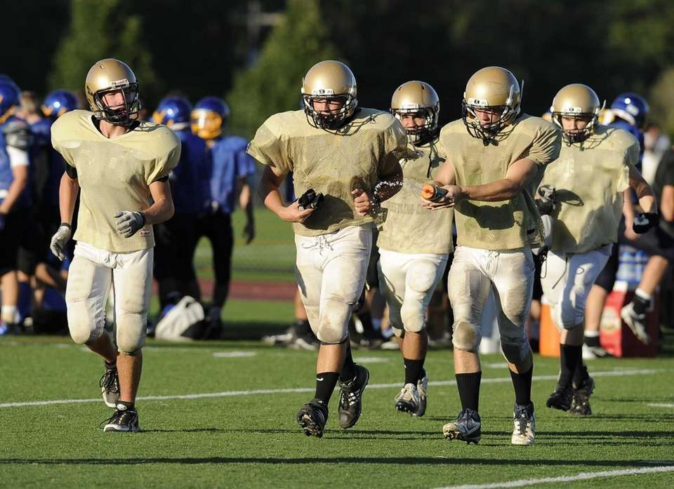 Bayport Blue Point players take the field during