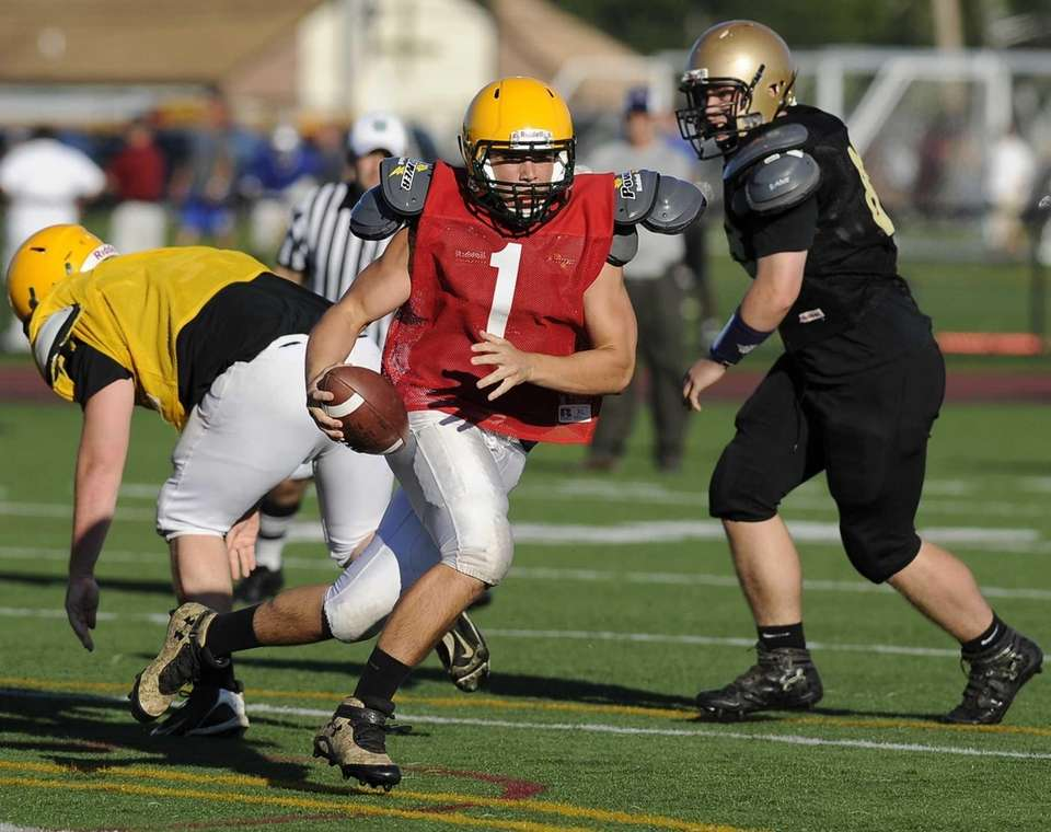 Ward Melville's quarterback scrambles against Sayville in the