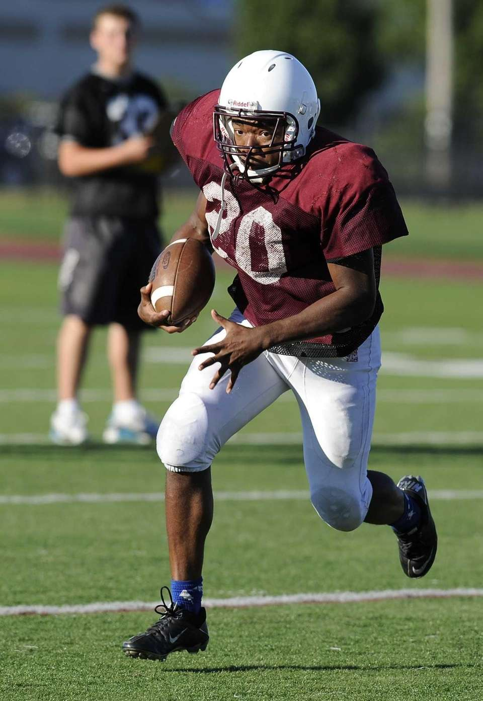 A Bay Shore receiver gains yardage against Sayville