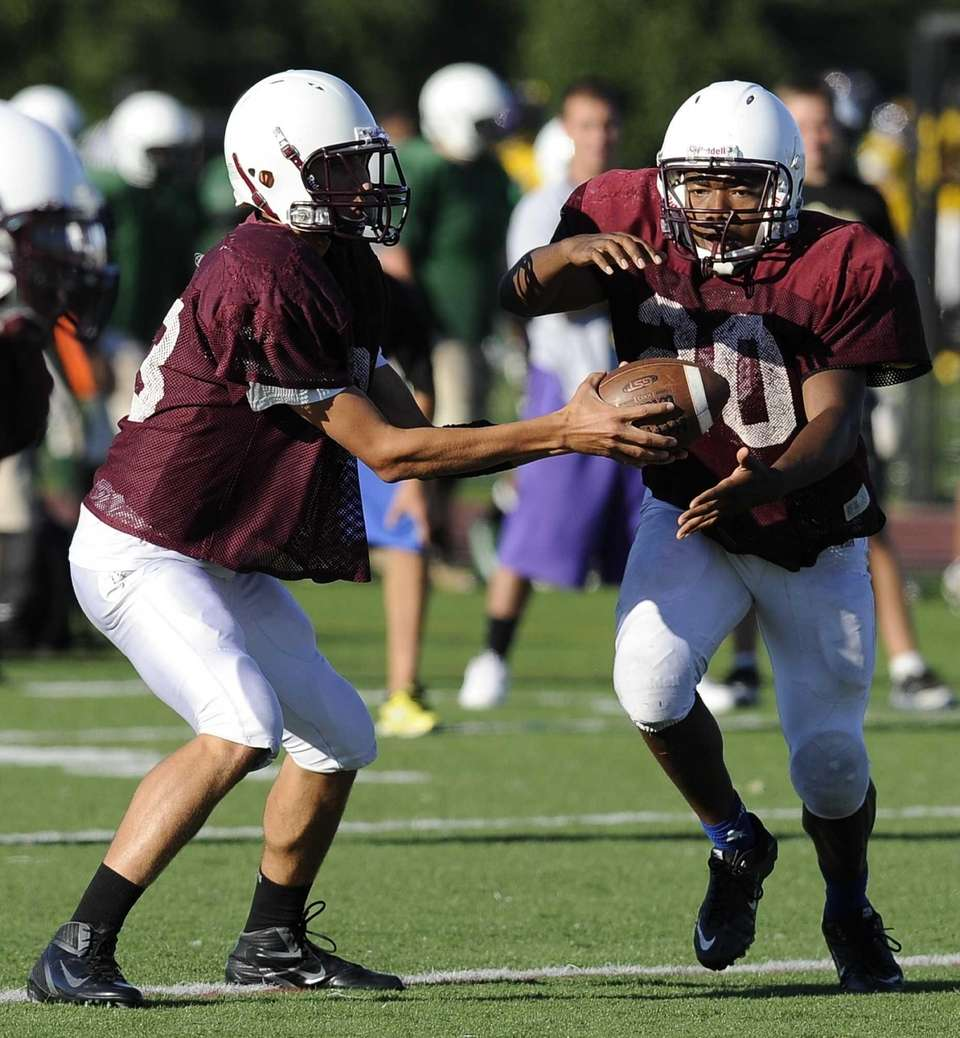Bay Shore's quarterback hands the ball off to