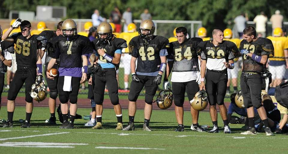Sayville teammates watch from the sidelines during the