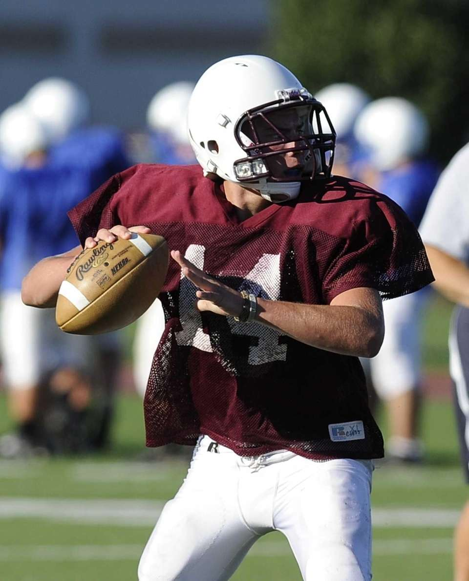 Bay Shore's quarterback looks to pass against Sayville